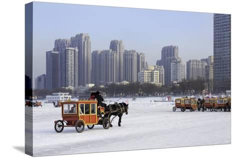 A Carriage on the Icebound Songhua River in Harbin, Heilongjiang, China, Asia-Gavin Hellier-Stretched Canvas Print
