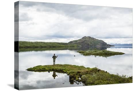 Man Fishing at Thingvallavatn Lake, Thingvellir (Pingvellir) National Park, Golden Circle, Iceland-Yadid Levy-Stretched Canvas Print