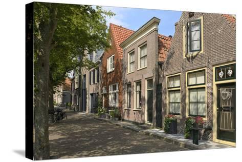 Street of Uniquely Individual Dutch Houses, Zuider Havendijk, Enkhuizen, North Holland, Netherlands-Peter Richardson-Stretched Canvas Print
