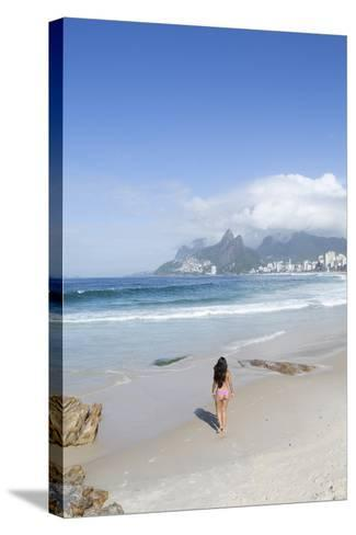 A 20-25 Year Old Young Brazilian Woman on Ipanema Beach with the Morro Dois Irmaos Hills-Alex Robinson-Stretched Canvas Print