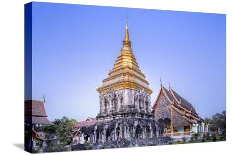 Elephant Sculptures on the Chedi Chang Lom and the Main Bot at the Temple of Wat Chiang Man-Alex Robinson-Stretched Canvas Print