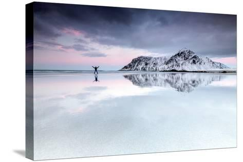 Sunset and Hiker on Skagsanden Beach Surrounded by Snow Covered Mountains-Roberto Moiola-Stretched Canvas Print