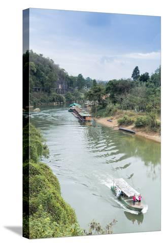 A Boat on the River Kwai with the Pow-Built Wampoo Viaduct Behind-Alex Robinson-Stretched Canvas Print