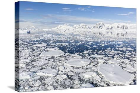 Snow-Covered Mountains Line the Ice Floes in Penola Strait, Antarctica, Polar Regions-Michael Nolan-Stretched Canvas Print