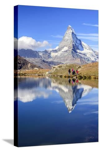 Hikers Walking on the Path Beside the Stellisee with the Matterhorn Reflected-Roberto Moiola-Stretched Canvas Print