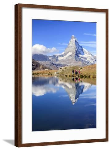 Hikers Walking on the Path Beside the Stellisee with the Matterhorn Reflected-Roberto Moiola-Framed Art Print