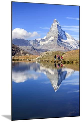 Hikers Walking on the Path Beside the Stellisee with the Matterhorn Reflected-Roberto Moiola-Mounted Photographic Print