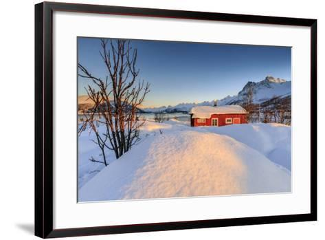 The Winter Sun Illuminates a Typical Norwegian Red House Surrounded by Fresh Snow-Roberto Moiola-Framed Art Print