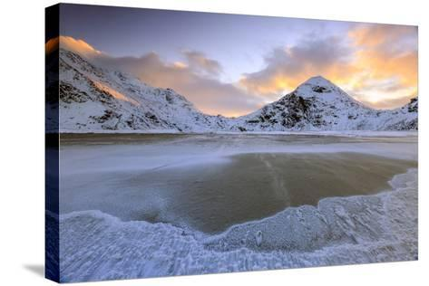 Wave Advances Towards the Shore of the Beach Surrounded by Snowy Peaks at Dawn-Roberto Moiola-Stretched Canvas Print
