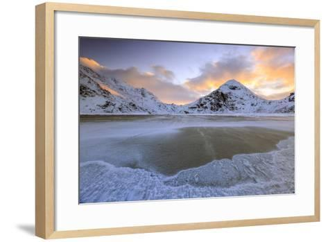 Wave Advances Towards the Shore of the Beach Surrounded by Snowy Peaks at Dawn-Roberto Moiola-Framed Art Print