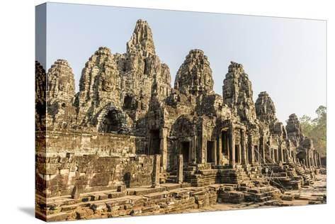 Four-Faced Towers in Prasat Bayon, Angkor Thom, Angkor, UNESCO World Heritage Site, Cambodia-Michael Nolan-Stretched Canvas Print