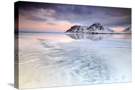 Sunset on Skagsanden Beach Surrounded by Snow Covered Mountains Reflected in the Cold Sea-Roberto Moiola-Stretched Canvas Print