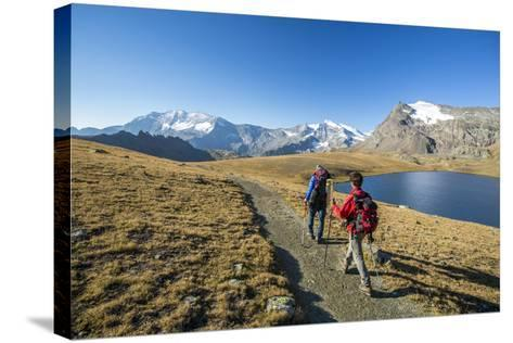 Hikers Wallking Along Rosset Lake, Gran Paradiso National Park, Alpi Graie (Graian Alps), Italy-Roberto Moiola-Stretched Canvas Print
