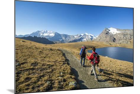 Hikers Wallking Along Rosset Lake, Gran Paradiso National Park, Alpi Graie (Graian Alps), Italy-Roberto Moiola-Mounted Photographic Print
