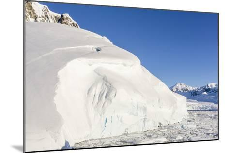 Snow-Covered Mountains Line the Ice Floes in Penola Strait, Antarctica, Polar Regions-Michael Nolan-Mounted Photographic Print