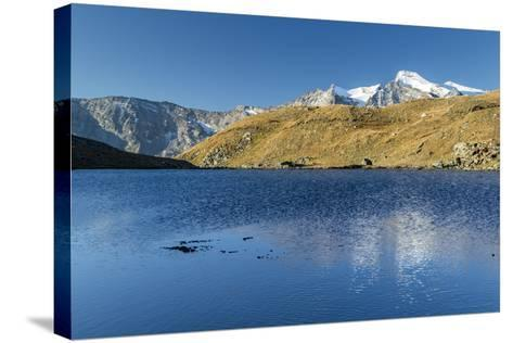 Sunrise and Reflections on Aiguille Rousse-Roberto Moiola-Stretched Canvas Print