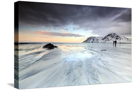 Sunset and Hikers on Skagsanden Beach Surrounded by Snow Covered Mountains-Roberto Moiola-Stretched Canvas Print