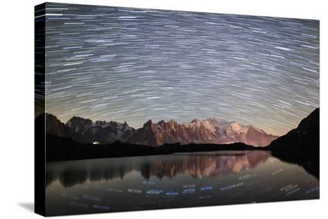 Star Trail over Mont Blanc Range Seen from Lac Des Cheserys-Roberto Moiola-Stretched Canvas Print