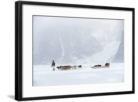 Inuit Hunter Walking His Dog Team on the Sea Ice in a Snow Storm, Greenland, Denmark, Polar Regions-Louise Murray-Framed Art Print