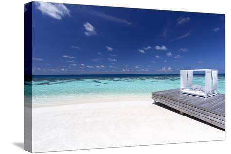 Sofa at the Beach in the Maldives, Indian Ocean-Sakis Papadopoulos-Stretched Canvas Print