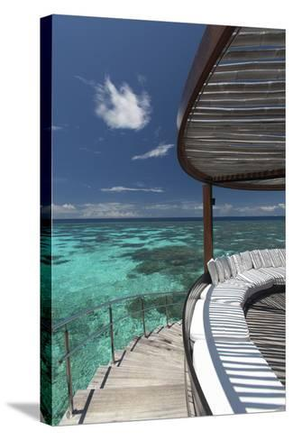 Stairs to the Beach and Sofa Overlooking the Ocean, Maldives, Indian Ocean-Sakis Papadopoulos-Stretched Canvas Print