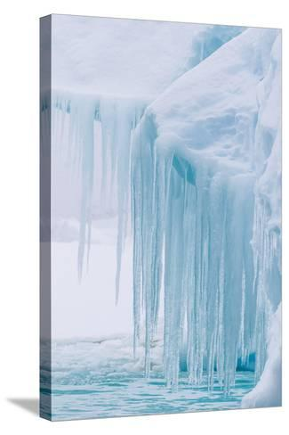 Wind and Water Sculpted Iceberg with Icicles at Booth Island, Antarctica, Polar Regions-Michael Nolan-Stretched Canvas Print