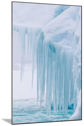 Wind and Water Sculpted Iceberg with Icicles at Booth Island, Antarctica, Polar Regions-Michael Nolan-Mounted Photographic Print