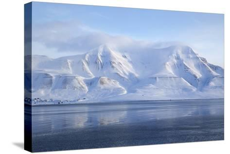 Hiorthfjellet Mountain, Adventfjorden (Advent Bay) Fjord with Sea Ice in Foreground, Svalbard-Stephen Studd-Stretched Canvas Print