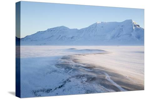 Sunrise, Hiorthfjellet Mountain and Adventtoppen Mountain across Adventdalen, Spitsbergen-Stephen Studd-Stretched Canvas Print