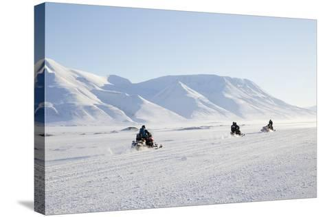 Snow Mobiles, Adventdalen Valley, Longyearbyen-Stephen Studd-Stretched Canvas Print