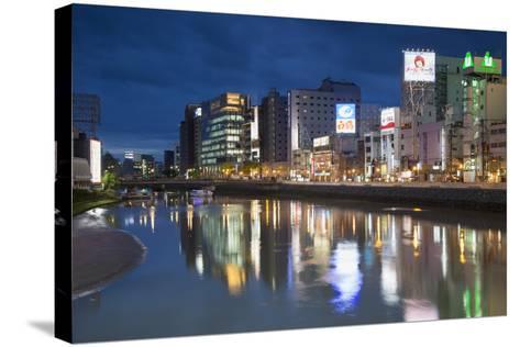 Buildings Along Hakata River at Dusk, Fukuoka, Kyushu, Japan-Ian Trower-Stretched Canvas Print
