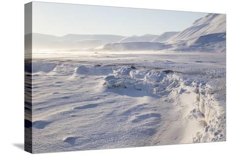 Adventdalen Valley, Frozen Sea Ice of Adventfjorden (Advent Bay), Svalbard-Stephen Studd-Stretched Canvas Print