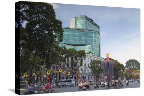 Traffic Passing Diamond Plaza, Ho Chi Minh City, Vietnam, Indochina, Southeast Asia, Asia-Ian Trower-Stretched Canvas Print