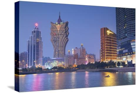 Grand Lisboa and Wynn Hotel and Casino at Dusk, Macau, China, Asia-Ian Trower-Stretched Canvas Print
