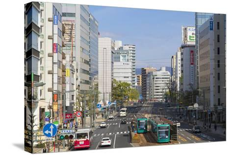 Trams and Traffic, Hiroshima, Hiroshima Prefecture, Japan-Ian Trower-Stretched Canvas Print