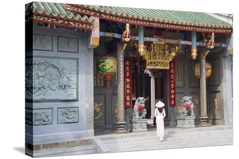 Woman Wearing Ao Dai Dress at Nghia an Hoi Quan Pagoda, Cholon, Ho Chi Minh City, Vietnam-Ian Trower-Stretched Canvas Print