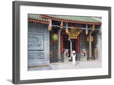 Woman Wearing Ao Dai Dress at Nghia an Hoi Quan Pagoda, Cholon, Ho Chi Minh City, Vietnam-Ian Trower-Framed Art Print
