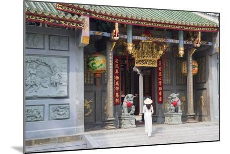 Woman Wearing Ao Dai Dress at Nghia an Hoi Quan Pagoda, Cholon, Ho Chi Minh City, Vietnam-Ian Trower-Mounted Photographic Print