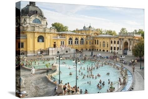 People Soaking and Swimming in the Famous Szechenhu Thermal Bath, Budapest, Hungary-Kimberly Walker-Stretched Canvas Print