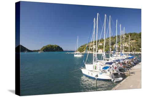 View across Lakka Bay, Yachts Lined Up Along the Quay, Lakka-Ruth Tomlinson-Stretched Canvas Print
