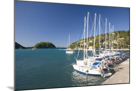 View across Lakka Bay, Yachts Lined Up Along the Quay, Lakka-Ruth Tomlinson-Mounted Photographic Print