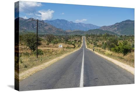 Long Straight Road in Central Malawi, Africa-Michael Runkel-Stretched Canvas Print