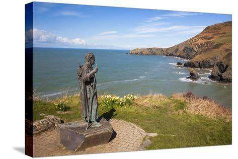 Statue of St. Carannog, Llangrannog Beach, Ceredigion (Cardigan), West Wales, Wales, UK-Billy Stock-Stretched Canvas Print
