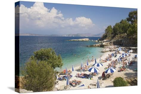 Beach Crowded with Holidaymakers, Kassiopi, Corfu, Ionian Islands, Greek Islands, Greece, Europe-Ruth Tomlinson-Stretched Canvas Print