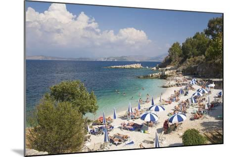 Beach Crowded with Holidaymakers, Kassiopi, Corfu, Ionian Islands, Greek Islands, Greece, Europe-Ruth Tomlinson-Mounted Photographic Print