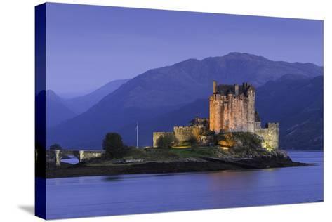 Eilean Donan Castle Floodlit at Night on Loch Duich, Scotland, United Kingdom-John Woodworth-Stretched Canvas Print
