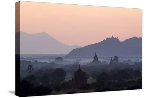 Temples, Pagodas and Stupas in Early Morning Mist at Sunrise, Bagan (Pagan), Myanmar (Burma)-Stephen Studd-Stretched Canvas Print