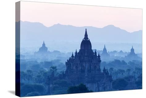 Temples and Pagodas in Early Morning Mist at Dawn, Bagan (Pagan), Myanmar (Burma)-Stephen Studd-Stretched Canvas Print