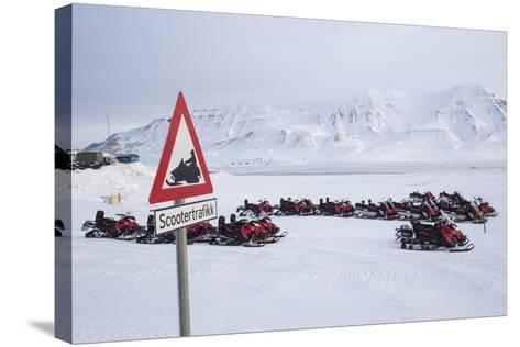 Snow Mobile Traffic Sign in Front of Snow Mobiles-Stephen Studd-Stretched Canvas Print