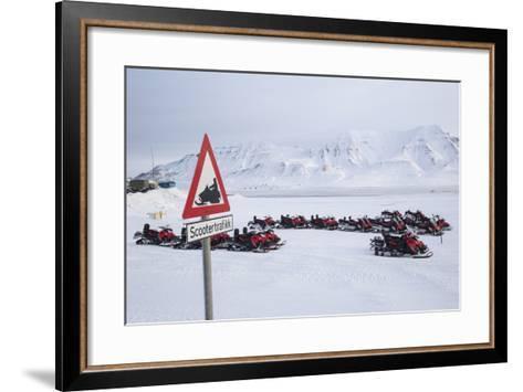 Snow Mobile Traffic Sign in Front of Snow Mobiles-Stephen Studd-Framed Art Print